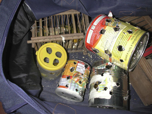 Smuggling, forgery of documents, and the mixture of legal and illegal products are the favorite techniques used by traffickers of wild species. In the photo are small birds in tin cans and a cage, discovered during a seizure in Brazil. Credit: World Animal Protection