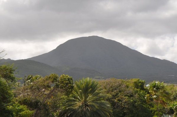 Mount Nevis sits at the centre of the volcanic island of Nevis, which has reserves of geothermal energy. Nevis is the smaller island of the pair, known as the Federation of St. Kitts and Nevis. Credit: Desmond Brown/IPS