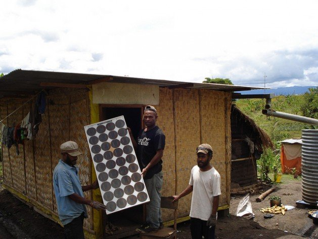 Communities in rural Papua New Guinea install their own cost effective and energy efficient solar panels. Credit: Catherine Wilson/IPS
