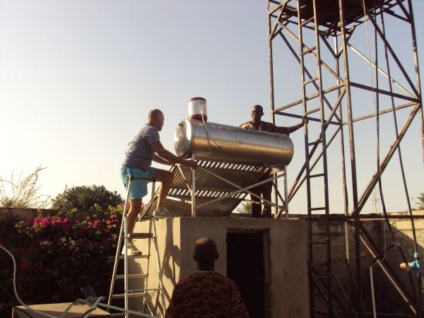 3e: New solar water heater being installed for the restaurant and staff supply