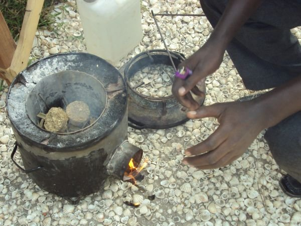 3i1: This is the groundnut briquette cooker in use at our lodges and being demonstrated as an alternative to charcoal,use of which threatens the precious trees in Gambia. We promote this recycled fuel for staff use as well as for guest barbeques.