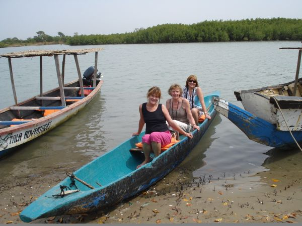 I am with 2 guests in a wooden pirogue for a trip on the Allehein river to view the mangroves at close quarters.