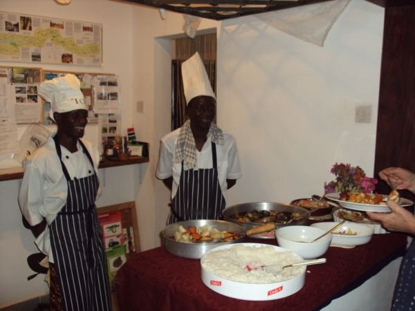 4j: Our two chefs serving at our New Year's Eve buffet ...Lamin (on the left) has been our chef since opening and he has helped to train Alkali who joined us 2 years ago straight from catering college.