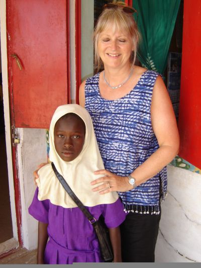 4o: One of our guests at school with the child she had chosen to sponsor throughout her education.