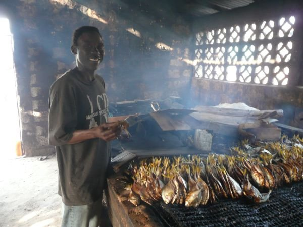 5c: In the fish -smoking sheds at Tanje...one of the recommended trips that many of our guests enjoy. We include a visit to the cultural museum in the village and watching the fishing boats arrive at the end of the day. We have our own guide who explains everything.