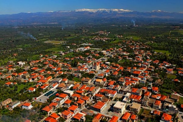 Aerial view of the village and snow-capped peaks in the spring.