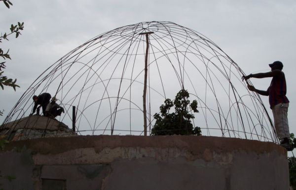 3b. This kind of construction is very typically African and is known as a tension dome. It is fire proof, water proof and sound proof using all local materials and again my current staff.