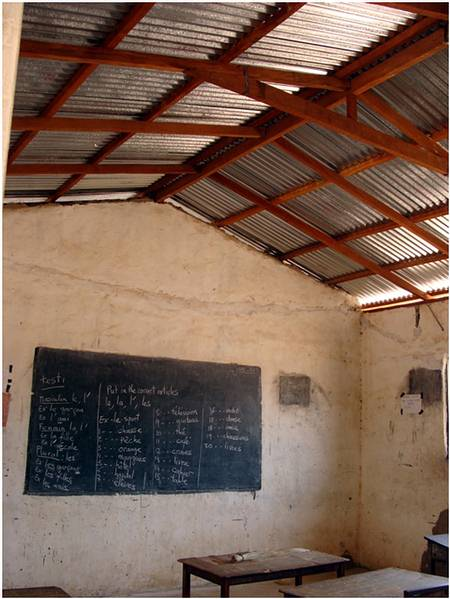 4o3. New roofs for 3 classrooms at the Gunjur Upper Basic school.