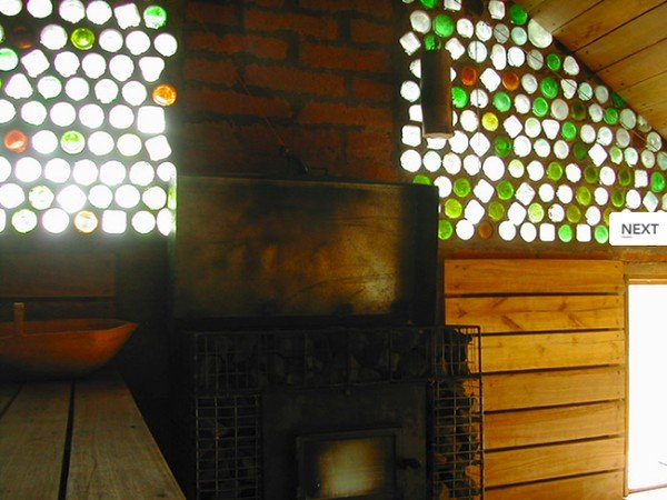Wood-stove sauna, with a wall made of recycled booze bottles.