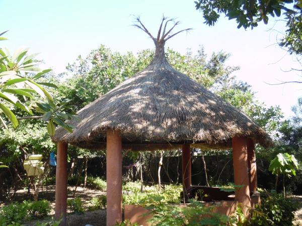 One of 5 thatched seating areas within the grounds...by a local thatcher using grasses from up-river